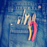 Herramientas en un bolsillo de los trabajadores Fotografía de archivo