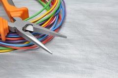 Herramientas para el electricista y los cables Imágenes de archivo libres de regalías