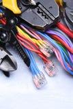 Herramientas para el electricista y los cables eléctricos Foto de archivo libre de regalías
