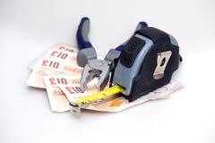 Herramientas y dinero Foto de archivo