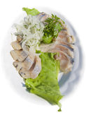 Herring. With onions and salad Stock Image