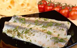 Herring on black plate Stock Images