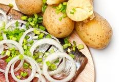 Herring with boiled potato Stock Photo