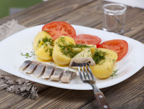 Herring with boiled potatoes Stock Photography