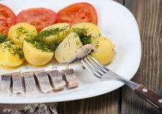 Herring with boiled potatoes Royalty Free Stock Image
