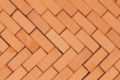Herring -bone pattern. On a basement with red bricks Royalty Free Stock Images
