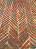 Herring bone pattern. Close-up of rustic bricks laid out in herring bone pattern Royalty Free Stock Images