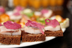 Herring canapes in plate, close-up Stock Image