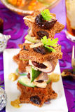 Herring canapes with prune  for christmas Royalty Free Stock Photo