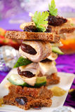Herring canapes with prune  for christmas Royalty Free Stock Photos