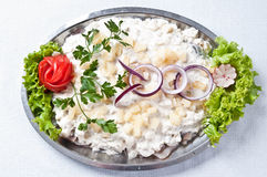 Herring in cream dish Stock Photo