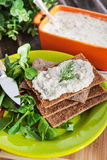 Herring creamy pate on a crispbread Stock Photography