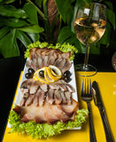 Herring decorated with lemon, onion and parsley on Stock Photos