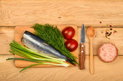 Herring double fillet with vegetables on wooden table Royalty Free Stock Photos