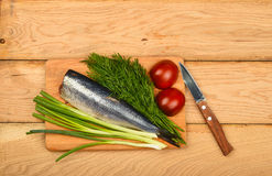 Herring double fillet with vegetables on wooden table Stock Photos