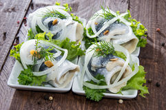 Herring Filet on small plates Stock Photos