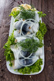 Herring Filets on a plate Royalty Free Stock Images