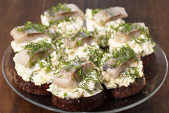 Herring fillet on toasted rye bread Stock Photo
