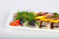 Herring fillet. With young potato and onion Royalty Free Stock Images