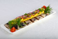 Herring fillet. With young potato and onion Royalty Free Stock Photo
