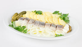 Herring fish fillets with potato and onion. Portion of herring fish fillets with potato and onion on a plate Stock Photo