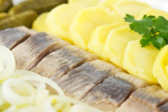 Herring fish fillets with potato and onion. Portion of herring fish fillets with potato and onion Stock Photo