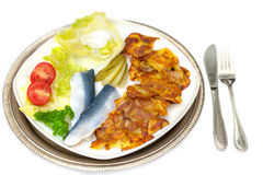 Herring  with fried potatoes Stock Photo
