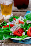 Herring ,green beans, and tomatoes summer salad. Stock Image
