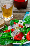 Herring ,green beans, and tomatoes summer salad. Royalty Free Stock Image