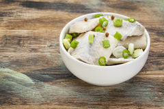 Herring with green onion Royalty Free Stock Photos