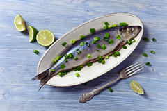 Herring with green onion. On a wooden table Stock Photo
