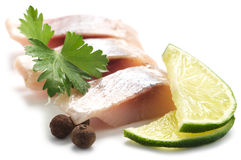 Herring with lime and pepper Stock Photos