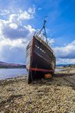 The wreck of a fishing trawler at Corpach near Fort William in the Highlands of Scotland. This herring and mackerel fishing trawler was originally launched in Stock Photo