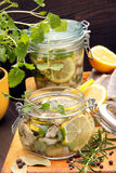 Herring marinated in oil with lemon and herbs Royalty Free Stock Photo