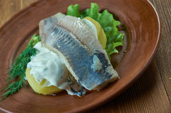 Herring with mustard potato salad. Herring with dill and Scandinavian mustard potato salad Stock Photos