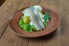 Herring with mustard potato salad. Herring with dill and Scandinavian mustard potato salad Royalty Free Stock Image