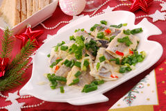 Herring in oils with chive and onion for christmas Stock Photos