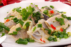 Herring in oils with chive and onion for christmas Stock Photo