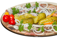 Herring with an onions and pickled vegetables Stock Images