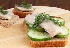 Herring on a piece of rye bread Stock Photography