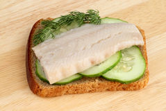 Herring on a piece of rye bread Stock Photos