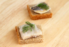 Herring on a piece of rye bread Royalty Free Stock Photography