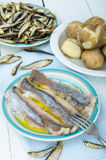 Herring and potato. Marinated herring and potato with olive oil Royalty Free Stock Photo
