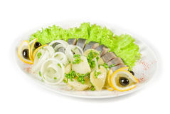 Herring with potato and vegetables. Isolated on a white background Stock Images