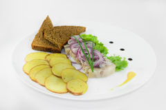 Herring with potato and vegetables  on a white background. Delicious dish with potatos and fish Stock Photos