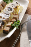 Herring with potatoes. Pieces of boiled potatoes with herring and onion Stock Photo