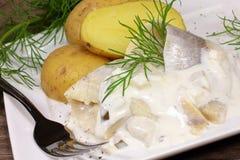 Herring with potatoes Stock Photo