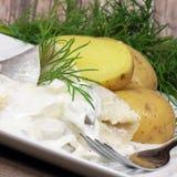 Herring with potatoes Stock Photos