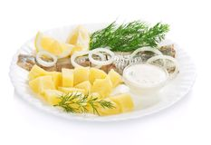 Herring and potatoes with sauce for a breakfast Royalty Free Stock Images