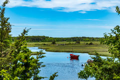 Herring River Cape Cod. The Herring River in Harwich, Massachusetts, has been of vital importance to three Cape Cod industries, cranberries, ship building, and Royalty Free Stock Images